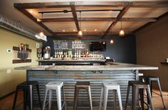 rustic corrugated steel bar with industrial  stools