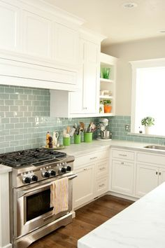 carrera marble + colored subway tile
