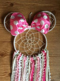 MINNIE MOUSE INSPIRED DREAMCATCHER Beautifully crafted one of a kind dreamcatchers! Perfect for: home decor, nurseries, childrens bedrooms, birthdays, parties, photo props, and much more! Handmade in NJ. Medium Size Dreamcatcher Made with 8 and 5 inch ring. Completed with sequin