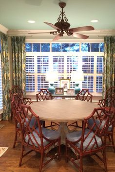 Mix Chairs in their new home.  Natural Bamboo chippendale chairs around a round dining table. So posh.