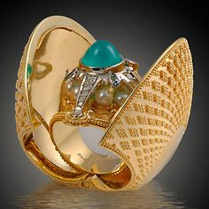 """Cosmic Clam Ring  18K yellow gold, 900 platinum, chrysacolla, diamonds, sapphires and pearls. Created in 2006 for the AJDC annual theme project """"Secret Treasure"""". The clam can be worn closed as a ring, or can be opened to reveal a removable inner ring. 1.75""""H X 2""""L X 1"""""""