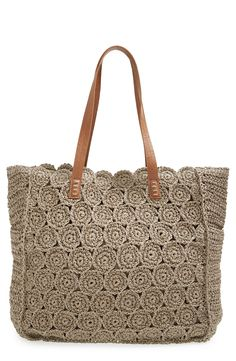 shipping and returns on Straw Studios Crochet Tote at . Perfect for hauling goods from the farmer's market, this spacious warm-weather tote is crocheted from natural straw and is outfitted with smooth handles. Bag Crochet, Crochet Clutch, Crochet Handbags, Crochet Purses, Crochet Summer, Free Crochet, Nordstrom, Summer Purses, Knitted Bags