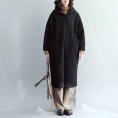 vintage black Wool Coat oversized hooded maxi coat vintage coats Flattering cut. Makes you look slimmer and matches easily.Custom make service available!  Please feel free to contact us if you want this dress custom made. Materials used:woolen  cotton  polyester Measurement:One size fits all for this item. Please make sure your size doesn't exceed this size: BUST-140cm      length 107cm / 41.73