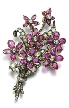 Ruby and diamond brooch, early 19th century. Of bouquet design, set with oval rubies and rose diamonds. #Victorian #LateGeorgian #antique #brooch