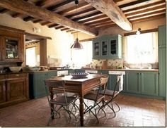 Green cabinets, exposed rafters, a big table...this is my kitchen dream. by aline