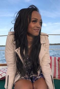 Rachel Lindsay wearing AllSaints Balfern Leather Jacket in Washed Pink, Likely Floral Print Dress and Jules Smith Circle Hoop Earrings