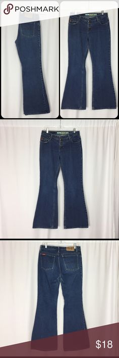 """Vintage 90s MUDD High Waist Button Fly Flare Jeans Vintage 90's High Waist Super Worn Button Fly Flare Jeans By MUDD. •Great vintagecondition. •100% cotton denim. •High waistline •Button fly- Tiny hole by bottom button. •Flare legs. •Labeled a size 11. Measurements of the jeans in inches when flat: •Waist: 16"""" •Rise: 9"""" •Hips: 19"""" •Inseam: 32"""" •Cuff: 11"""" •Length: 41"""" Feel free to contact me with any questions you may have about these jeans. Please take a look at my…"""