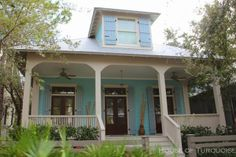 These light blue Board and Batten shutters complete the coastal appeal of this home in WaterColor, Florida.