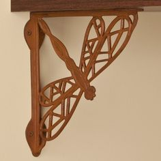 Dragonfly Iron Shelf Bracket - Rust by Whittington Collection. $18.95. Sturdy cast iron construction and a fun design make the Dragonfly Iron Shelf Bracket a natural addition to your home. Shown in Rust finish. Bracket dimensions: 9-1/2 L x 9-3/4 H. Bracket is 3/4 wide; 1-1/2 wide where the mounting screws are placed. Made of durable cast iron. Rust finish is actual oxidized iron, a living finish. Sold individually. Includes matching fastening hardware.