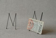 "Masao Seki's Wire Works via Spoon & Tamago. ""small picture stand"""