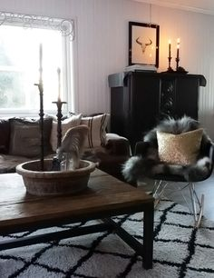 A Scandinavian Cottage by the Sea   Design*Sponge. Loving the crisp black and white made cozy with wood & textures.