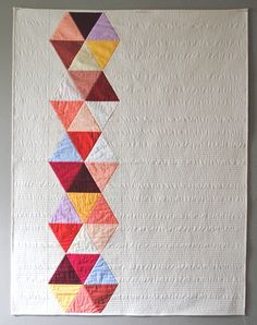 Rose Triangle Bead Quilt. $360.00, via Etsy.