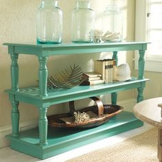 Using two old coffee tables to create a storage unit is a great idea, especially when painted in a striking colour !