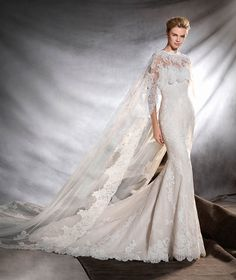 """Pronovias"""" Oringo"""" with cape #whitegownstyle #thewhitegown"""