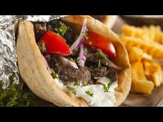 Yes, 'Gyro recipe' is spoken here. Gyros are Greek grilled lamb sandwiches with tzatziki sauce, onions, tomatoes and feta in pita bread. Much easier to make than to pronounce. Tzatziki Sauce, Kebabs, Popular Greek Food, Gyro Pita, Beef Gyro, Greek Gyros, Gyro Recipe, Shawarma Recipe, Vegetables