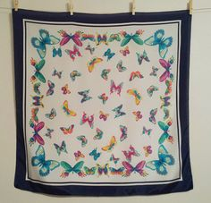 Bright butterflies and a navy blue border on a shiny, bright white background make this scarf pop. This beauty has no tag, but I feel certain that