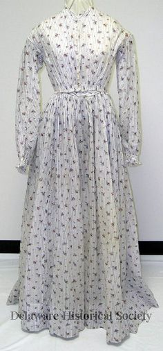 The dress Jane wore when Frank Dawson first kissed her in The Soldier's Love. A full-length day dress of white organdy printed with a small repeating pattern of pink and blue flower sprigs with a vertical brown stripe. Day Dresses, Dresses For Work, Vintage Dresses, Vintage Outfits, Civil War Dress, Bustle Dress, Gibson Girl, Clothing And Textile, Wool Dress