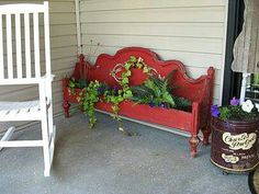 Old head board turned plant holder. Neat! Maybe for the front porch.