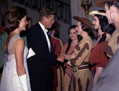 Greeting cast members from a production of Billy the Kid during a White House dinner honoring the president of the Republic of the Ivory Coast. http://www.rosettabooks.com/ebook/jfks-final-hours-in-texas/
