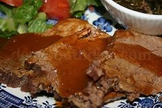 Coca Cola Roast Beef with Gravy - You HAVE to make this! A beef roast is transformed in the slow cooker to a tender and delicious roast with incredibly tasty gravy, using Coca-Cola Classic and an envelope of onion soup mix. Also great with root beer and Dr Pepper & for chicken and pork roast too!