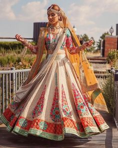 Bride wedding lehenga with multicoloured embroideries and borders make for an unconventional look to donn and make a statement. Indian Bridal Lehenga, Indian Bridal Fashion, Indian Bridal Wear, Indian Wedding Outfits, Bridal Outfits, Indian Outfits, Indian Clothes, Pakistani Bridal, Indian Weddings