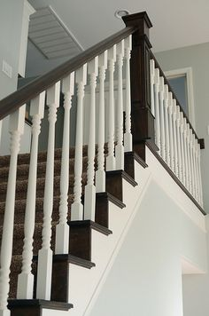 This is a gorgeous staircase.  Love the contrast of the white with dark wood.