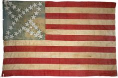 "34 Star American Flag c. 1847, handsewn linen with painted canton, ca.1847, with quite unusual canton pattern of painted 5-pointed stars in arrangement of a 4-pointed star, hand-sewn hoist, 67"" x 47""."