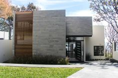 Closed-off front home facade architecture : by aaestudio Modern House Facades, Modern Architecture House, Facade Architecture, Residential Architecture, Modern House Design, Villa Design, Facade Design, Exterior Design, Living Haus