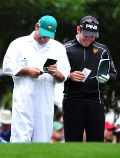 Louis Oosthuizen, right, and his caddie Wynand Stander smile before teeing off on the fourth hole  during Friday's second round of the 2012 Masters Tournament at Augusta National Golf Club on April 6, 2012, in Augusta, Ga.