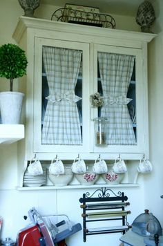 Cottage style kitchen cupboard on wall