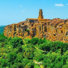 Pitigliano, Tuscany, Italy. Pitigliano is a stunning medieval town in the Maremma of Tuscany, dramatically perched atop a tufa ridge. Etruscan tombs dot the cliff face and valley.