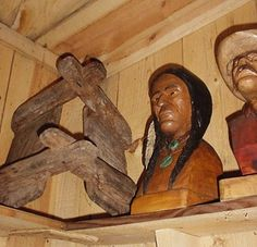 This is an old pack saddle tree and two wood carvings made by a wood carver that used the symbol CARP and a fish for his makers mark, his last name was Carpender