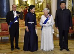 President of China Xi Jinping (right) and his wife Peng Liyuan (second left) accompany Bri...