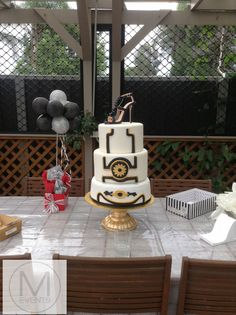 The Great Gatsby Inspired cake. Gold Black and white. With a Black Jimmy Choo Shoe as a cake topper.Great for birthday parties and weddings.