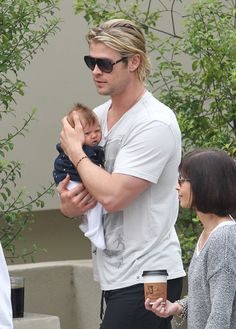 """Chris Hemsworth Photos Photos - """"Thor"""" star Chris Hemsworth carries his daughter India as he leaves Kafe K with his wife Elsa and some friends on July 12, 2012, in Santa Monica, California. - Chris Hemsworth Out With His Family 3"""