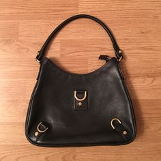 Gucci purse Black Gucci purse with gold details very  good condition! Gucci Bags