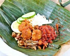 Nasi Lemak Bungkus, Malaysia's most popular breakfast now with sambal udang (prawn sambal). It is a gastronomical delight you don't want to miss.