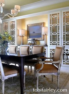 Glamorous contemporary dining room by Tobi Fairley