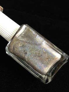 EVP4CI Elevation Polish Rick Ross The Boss Nail Polish: Holographic topper with gold flake shimmer, gold shimmer, and gold micro shimmer