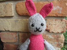 Hand-knit pink and gray plush bunny toy. $12.00, via Etsy.