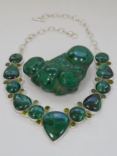 "Stunning highly polished artisan Malachite Necklace accented with 20 faceted round Peridot Quartz gemstones, bezel-set in 925-hallmarked sterling silver. Length: 15-20"" Longest center gemstone dimensi"