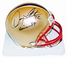 Doug Flutie Autographed Boston College Mini Helmet with Heisman 84 inscription by Autographed. $90.95. On Saturday July 21st as of part of our Week of Stars at our Orchard Park location was former National Football League and Buffalo Bills Great Doug Flutie. Doug's amazing 21 year professional football career he played for 8 teams in 3 different leagues. After 8 years playing the CFL, Doug made his return to the NFL with the Buffalo Bills, taking over as the starting QB wit...