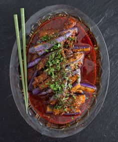 For his version of classic Shanghainese red-cooked eggplant, chef Danny Bowien employs nontraditional ingredients such as dill, chiles de àrbol, and anchovies.