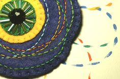 Embroidered blue felt brooch with black button por loopicraft, $20,00