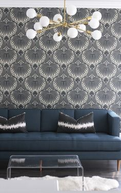 Becki Owens used Farrow and Ball Lotus wallpaper in a modern playroom.