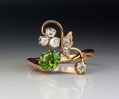 Antique Demantoid Diamond Gold Art Nouveau Ring | From a unique collection of vintage more rings at https://www.1stdibs.com/jewelry/rings/more-rings/