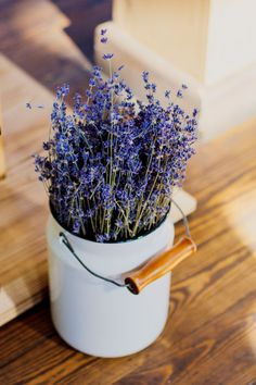 wedding decor - maybe use lavender flower as a part of the center pieces