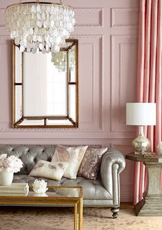 loving this mix of pink & gray, that coffee table & that chandelier!