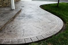Seamless Stamped Concrete patio with hand tooled border and porch with 2 inch rough granite overhang - pebble Davis integral color with storm gray antiquing release agent. By The Concrete Artisans, Inc. by The Concrete Artisans, Inc., via Flickr