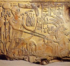 Relief of Amenhotep III in his chariot. God Nekhbet (vulture) is depicted hovering with her wings spread above the royal image, clutching an ankh (symbol of life) in her claws. Found in Temple of Merneptah (he used stones and reliefs from the 150 year older nearby Temple of Amenophis III), now in Cairo Museum, Egypt.